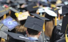 In this May 5, 2018, file photo, students attend the University of Toledo commencement ceremony in Toledo, Ohio. Colleges across the U.S. have begun cancelling and curtailing spring graduation events amid fears that the new coronavirus will not have subsided before the stretch of April and May when schools typically invite thousands of visitors to campus to honor graduating seniors.