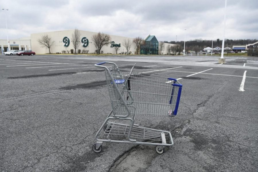 In this Tuesday, March 17, 2020, photo, a lone shopping cart sits in an empty parking lot near a shopping mall closed due to coronavirus concerns in Pottsville, Pa. In Pennsylvania last week, 12,200 people filed for unemployment insurance. In just a single day this week, that number exploded beyond 50,000. In neighboring Ohio, 48,460 people filed for unemployment Sunday and Monday, compared to less than 1,900 over the same period the week before. It's the same story in state after state, as millions of displaced Americans lose their jobs amid the widening shutdowns to contain the coronavirus.