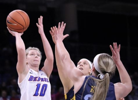 Lexi Held tries a floater over Marquette defenders in her 31 point effort at the 2020 Big East tournament.