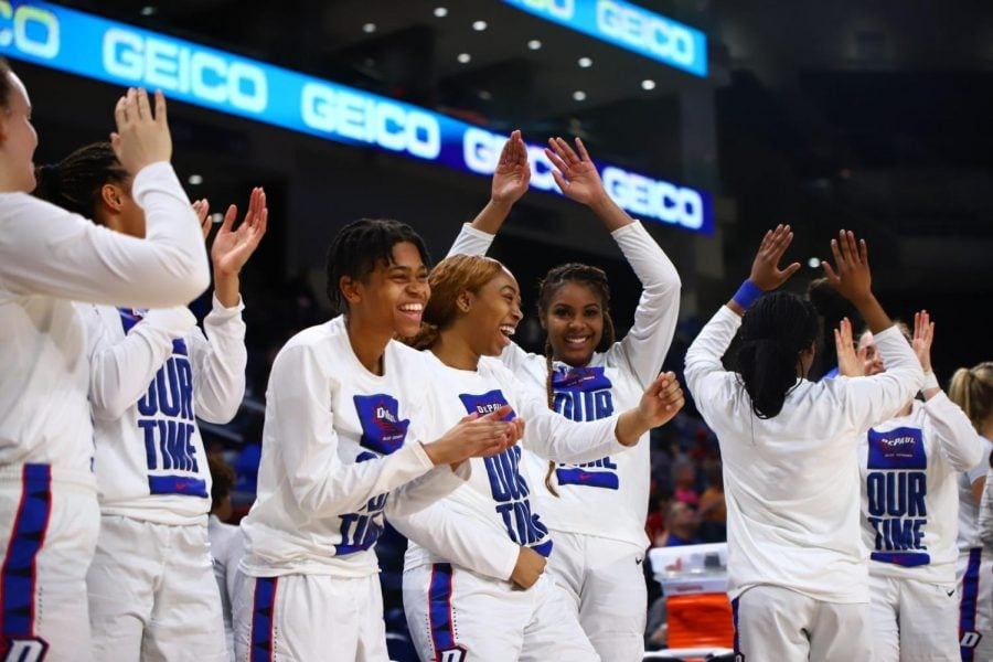 The DePaul women's basketball team celebrates during the team's 83-80 semifinals victory over Seton Hall in the Big East Tournament on Sunday at Wintrust Arena.