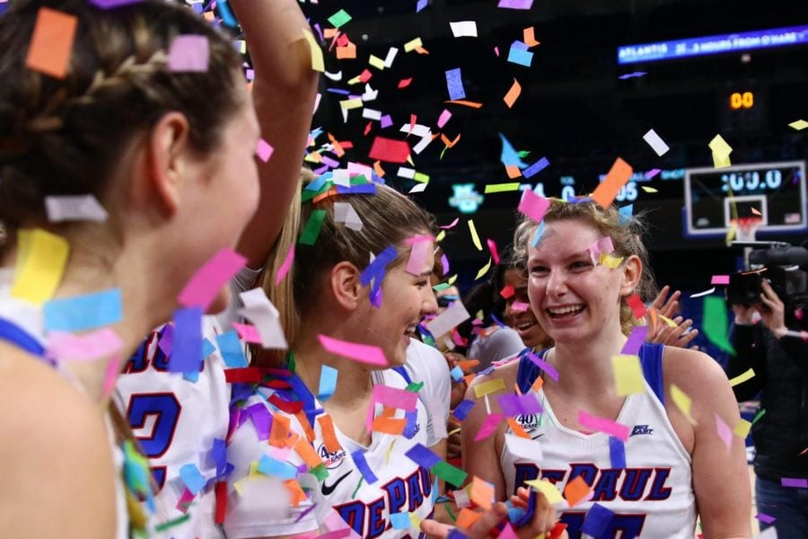 Lexi+Held+and+Dee+Bekelja+celebrate+after+the+game%2C+both+players+were+a+part+of+last+year%27s+championship+win+over+Marquette.+