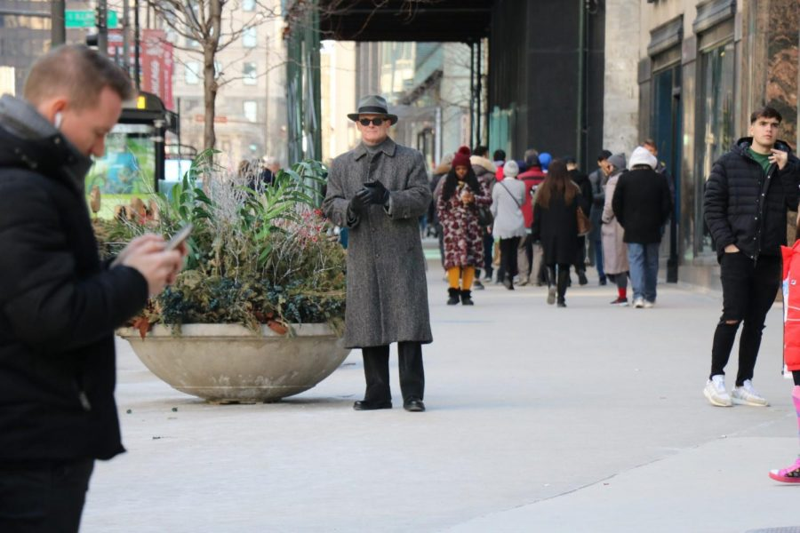 A man pauses on the street.