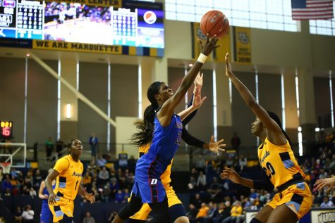 Chante Stonewall goes up for a shot in the second half against Marquette. The senior forward scored just 12 points on Sunday in the 90-82 loss to the rival Golden Eagles.