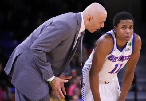 DePaul head coach Dave Leitao talks to junior guard Charlie Moore during the Blue Demons' 74-68 win over Georgetown on Feb. 22.