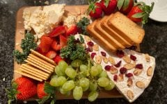 Wayne and Donavan's friends convinced the two to craft a charcuterie board their board included brie toast and crackers, brie and cheddar cheese, grapes, strawberries, kale, almonds and craisins. The friends spent time together while making the board and had a long conversation while devouring the board. Donavan photo.