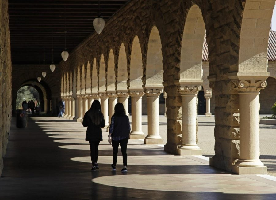In this March 14, 2019, file photo students walk on the Stanford University campus in Stanford, Calif.