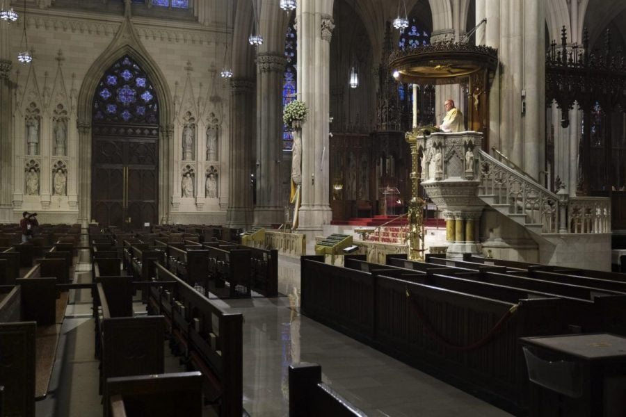 Archbishop+Timothy+Dolan%2C+right%2C+delivers+his+homily+over+empty+pews+as+he+leads+an+Easter+Mass+at+St.+Patrick%27s+Cathedral+in+New+York%2C+Sunday%2C+April+12%2C+2020.+Due+to+coronavirus+concerns%2C+no+congregants+were+allowed+to+attend+the+Mass+but+it+was+broadcast+live+on+a+local+TV+station.