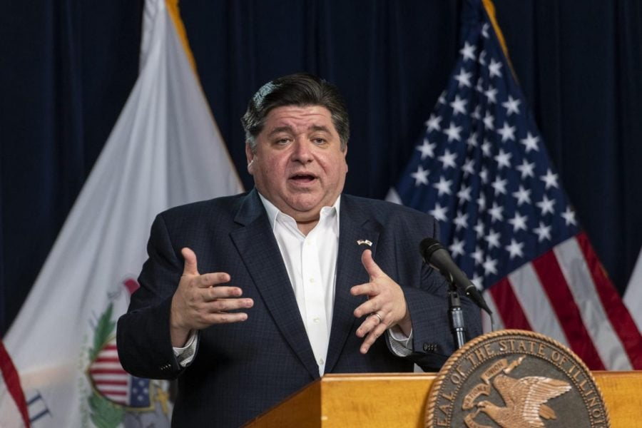 In this April 13, 2020 file photo, Illinois Gov. J.B. Pritzker gives a daily state update on the coronavirus outbreak in Chicago. Seven Midwestern governors announced Thursday, April 16, 2020 that they will coordinate on reopening their state economies amid the coronavirus pandemic, after similar pacts were made in the Northeast and on the West Coast. The latest agreement includes Illinois, Ohio, Michigan, Indiana, Wisconsin, Minnesota and Kentucky.
