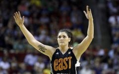 In this July 22, 2017 file photo, Chicago Sky's Stefanie Dolson raises her hands in the second half of the WNBA All-Star basketball game in Seattle. Dolson says she tested positive for the cororavirus. She is the first known Chicago professional athlete and the second WNBA player known to have contracted COVID-19. Dolson announced that she caught the virus in a video that aired Friday, April 17, 2020 during ESPN's broadcast of the WNBA draft.