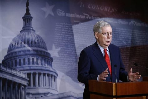 Senate Majority Leader Mitch McConnell of Ky., speaks with reporters after the Senate approved a nearly $500 billion coronavirus aid bill, Tuesday, April 21, 2020, on Capitol Hill in Washington.