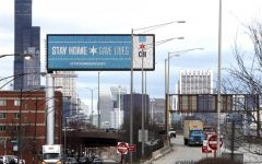 In this March 30, 2020, file photo, a public service message reminding people to Stay Home Save Lives is seen on a billboard near the Dan Ryan Expressway in Chicago. Illinois Gov. J.B. Pritzker on Thursday, April 23, 2020 extended his stay-at-home order through May 30 as the highly contagious COVID-19 continues its rounds. Pritzker's first decree was to expire April 30.