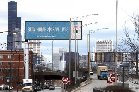 In this March 30, 2020, file photo, a public service message reminding people to Stay Home Save Lives is seen on a billboard near the Dan Ryan Expressway in Chicago. Illinois Gov. J.B. Pritzker on Thursday, April 23, 2020 extended his stay-at-home order through May 30 as the highly contagious COVID-19 continues its rounds. Pritzker