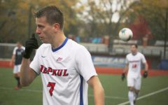 DePaul sophomore forward Jake Fuderer looks onto the field as pouring rain comes down on Oct. 27, 2019.