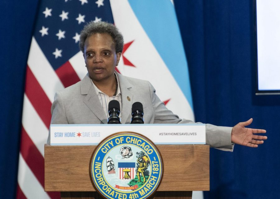 Mayor Lori Lightfoot answers a reporter's question during a news conference to provide an update to the latest efforts by the Racial Equity Rapid Response Team in Chicago on Monday, April 20, 2020.