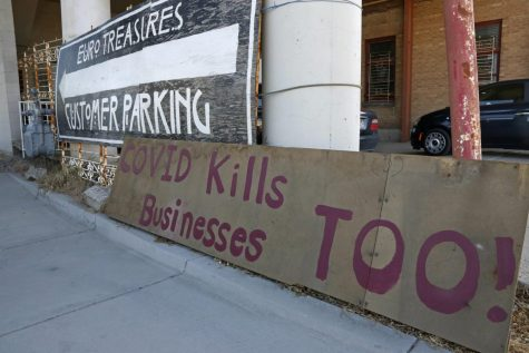 "A ""Covid kills businesses too"" sign is shown outside Euro Treasures Antiques Friday, May 8, 2020, in Salt Lake City. Scott Evans is closing his art and antique store after 40 years. With a drastic drop in customers due to COVID-19 concerns and shelter-in-place orders, Evans says it was no longer cost effective to stay open."