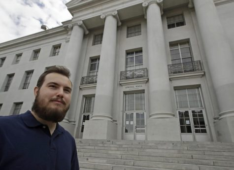 University of California at Berkeley graduate Tyler Lyson stands in front of Sproul Hall on the closed Cal campus in Berkeley, Calif., on Monday, May 11, 2020. Lyson watched his parents' financial collapse in the Great Recession, a decade ago. He vowed he'd find the security they never had: He would get a college degree.