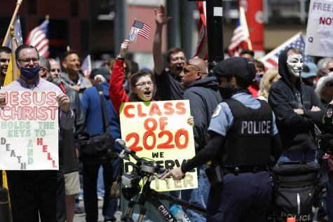 Reopen Illinois protesters rally outside Thompson Center in downtown Chicago, Saturday, May 16, 2020, during the coronavirus pandemic. (AP Photo/Nam Y. Huh)