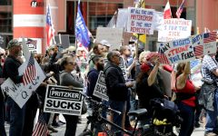 Protesters rally outside the Thompson Center in downtown Chicago, calling for Gov. J.B. Pritzker to reopen Illinois, Saturday, May 16, 2020. (AP Photo/Nam Y. Huh)