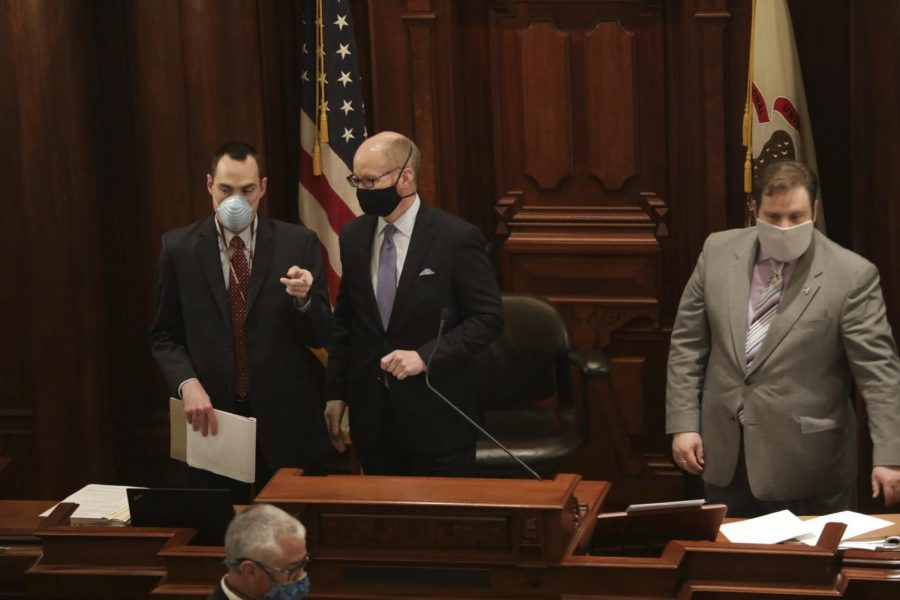 New Illinois Senate President Don Harmon, D-Oak Park, center, and others wear masks amid the coronavirus pandemic during session at the State Capitol, Wednesday, May 20, 2020, in Springfield, Ill.