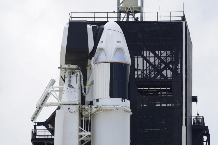 The+SpaceX+Falcon+9%2C+with+Dragon+crew+capsule+on+top+of+the+rocket%2C+sits+on+Launch+Pad+39-A%2C+Friday%2C+May+29%2C+2020%2C+at+the+Kennedy+Space+Center+in+Cape+Canaveral%2C+Fla.+Two+astronauts+will+fly+on+the+SpaceX+Demo-2+mission+to+the+International+Space+Station+scheduled+for+launch+on+Saturday%2C+May+30.+For+the+first+time+in+nearly+a+decade%2C+astronauts+will+blast+into+orbit+aboard+an+American+rocket+from+American+soil%2C+a+first+for+a+private+company.