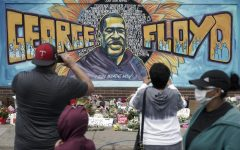 People gather on Friday May 29 at a memorial mural painted outside the Cup Foods store on Chicago Avenue in South Minneapolis where George Floyd died at the hands of police.