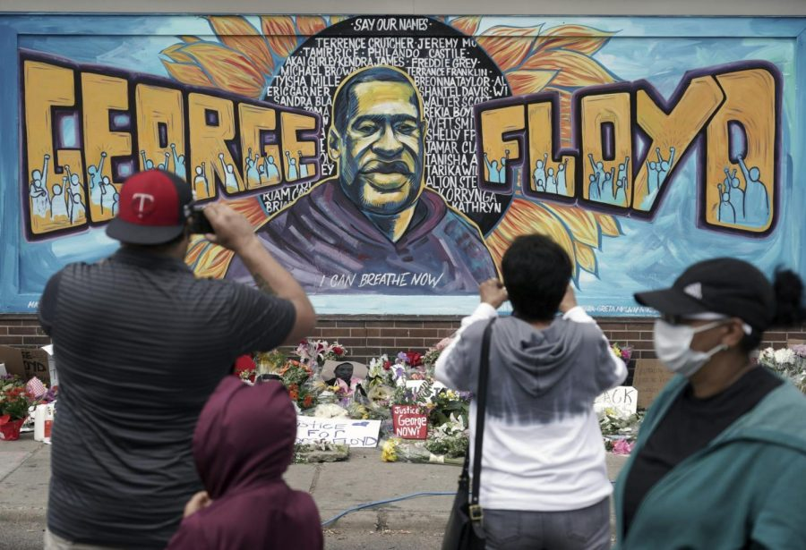 People+gather+on+Friday+May+29+at+a+memorial+mural+painted+outside+the+Cup+Foods+store+on+Chicago+Avenue+in+South+Minneapolis+where+George+Floyd+died+at+the+hands+of+police.