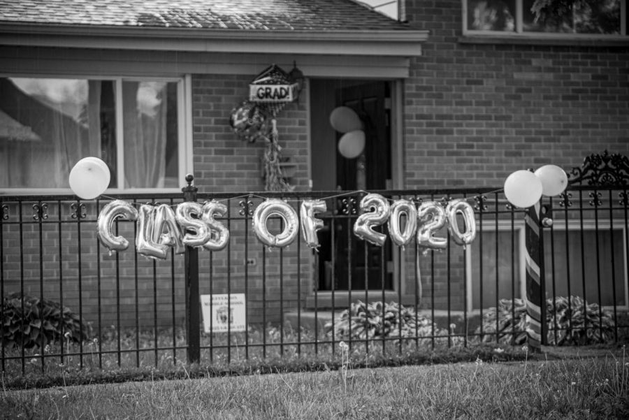 Balloons float in front of a house celebrating the graduating class of 2020 in Villa Park, IL.
