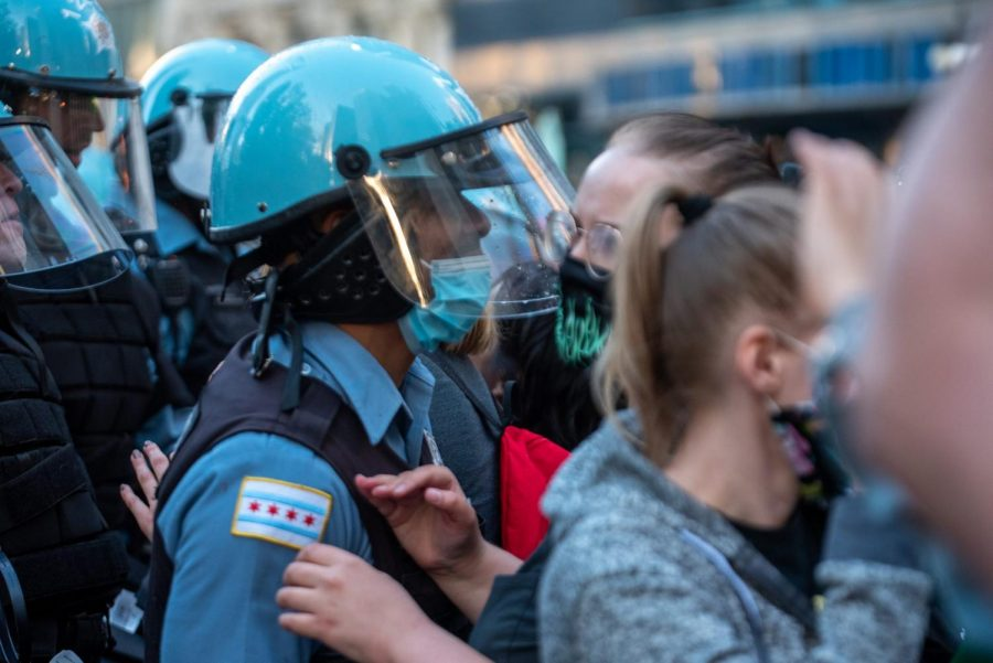 An officer attempts to block a protester.