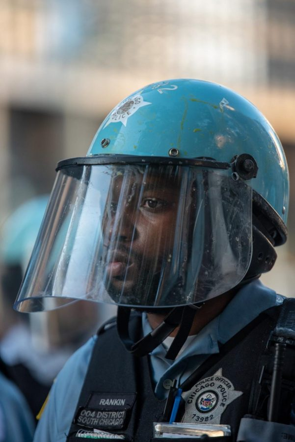 An officer wearing protective facial covering.