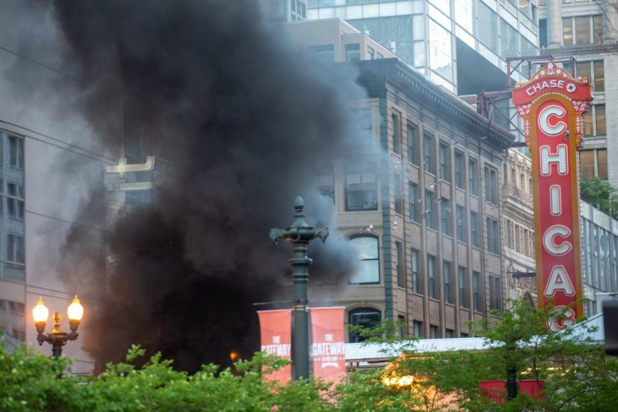 A cloud of smoke rises near the State and Lake intersection.