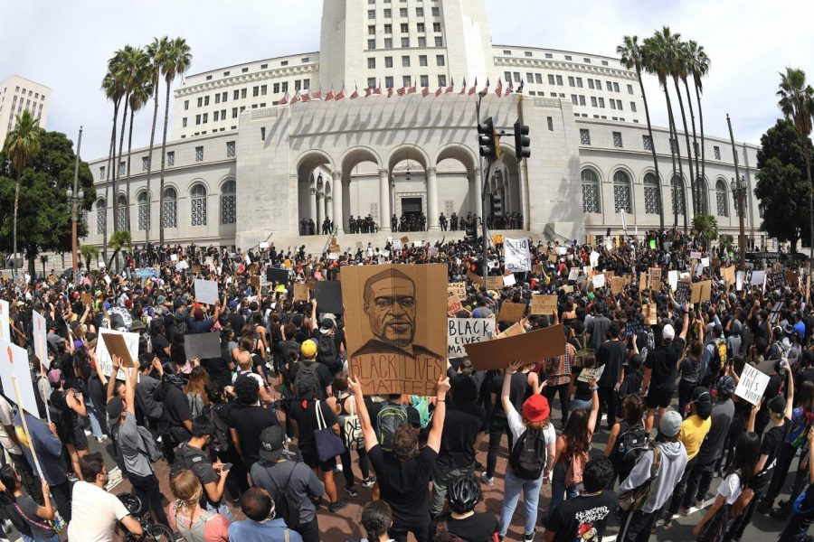 In+this+photo+taken+with+a+wide+angle+lens%2C+demonstrators+stand+in+front+of+Los+Angeles+City+Hall+during+a+protest+over+the+death+of+George+Floyd+Tuesday%2C+June+2%2C+2020%2C+in+Los+Angeles.+Floyd+died+in+police+custody+on+Memorial+Day+in+Minneapolis.