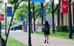 A student walks along the Quad, located in Lincoln Park.