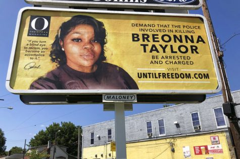 A billboard sponsored by O, The Oprah Magazine, is on display with with a photo of Breonna Taylor, Friday, Aug. 7, 2020 in Louisville, KY. Twenty-six billboards are going up across Louisville, demanding that the police officers involved in Taylor