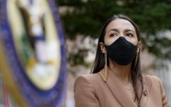 Representative Alexandria Ocasio-Cortez, D-New York, uses a face mask meanwhile waiting to speak at a press conference outside of USPS Jamaica station in Queens, New York. Democratic National Convention   AP Photo