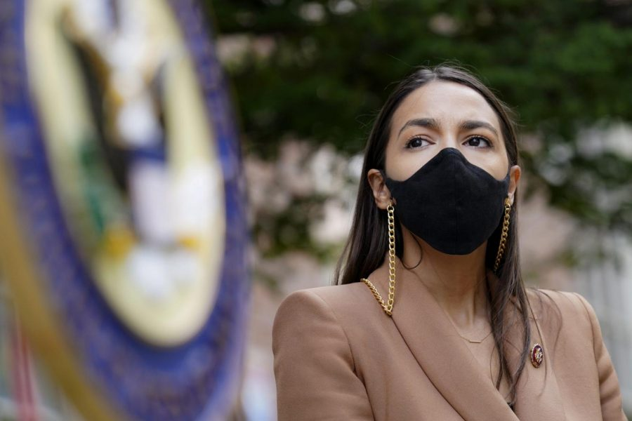 Representative Alexandria Ocasio-Cortez, D-New York, uses a face mask meanwhile waiting to speak at a press conference outside of USPS Jamaica station in Queens, New York. Democratic National Convention | AP Photo