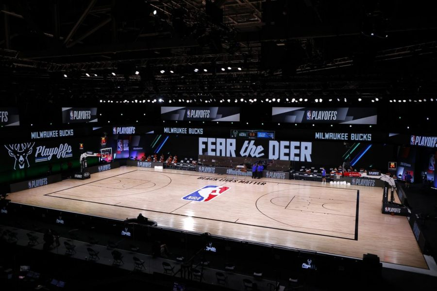 Referees+huddle+on+an+empty+court+at+game+time+of+a+scheduled+game+between+the+Milwaukee+Bucks+and+the+Orlando+Magic+for+Game+5+of+an+NBA+basketball+first-round+playoff+series%2C+Wednesday%2C+Aug.+26%2C+2020%2C+in+Lake+Buena+Vista%2C+Fla.