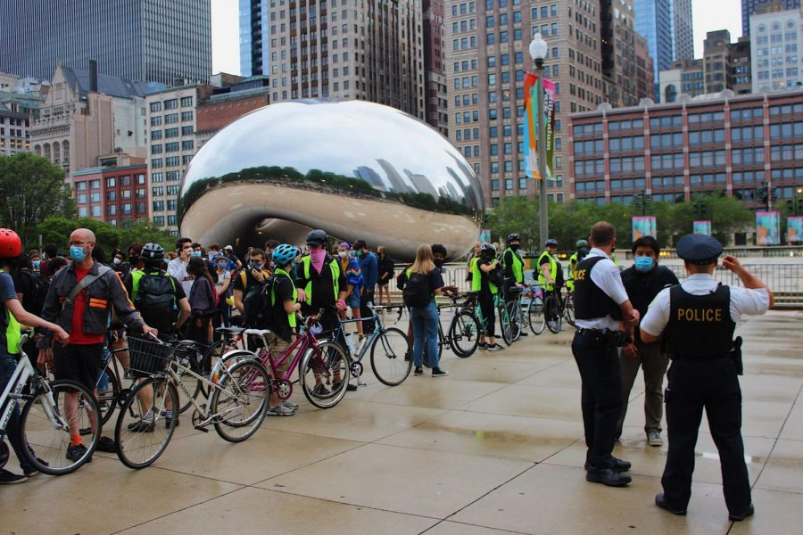 Protesters gather near The Bean in Millenium Park August 1 for the Solidarity Street: Abolish CPD Block Party.