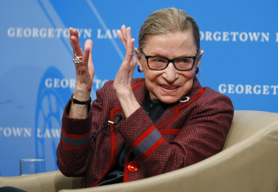 FILE+-+In+this+April+6%2C+2018%2C+file+photo%2C+Supreme+Court+Justice+Ruth+Bader+Ginsburg+applauds+after+a+performance+in+her+honor+after+she+spoke+about+her+life+and+work+during+a+discussion+at+Georgetown+Law+School+in+Washington.+The+Supreme+Court+says+Ginsburg+has+died+of+metastatic+pancreatic+cancer+at+age+87.+%28AP+Photo%2FAlex+Brandon%2C+File%29