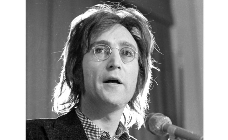 FILE - John Lennon speaks as he arrived for a hearing on his case at U.S. Immigration and Naturalization Service offices in the lower Manhattan section of New York, May 12, 1972. Like so many other events in the year of coronavirus, an annual tribute to John Lennon held in its adopted city of New York will go online. The five-hour event will be streamed for free on Lennon's birthday, October 9, starting at 7 p.m. Eastern time on the LennonTribute.org website. It will feature recorded performances from Patti Smith, Rosanne Cash, Natalie Merchant, Jackson Browne, Jorma Kaukonen and others. (AP Photo/Ron Frehm)