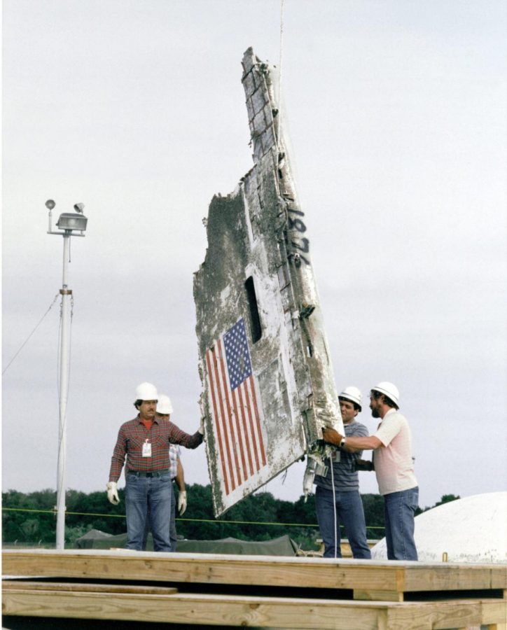 STS-51L+Challenger+wreckage+remains+and+boxes+of+debris+being+lowered+into+abandoned+Minuteman+Missile+Silos+at+Complex+31+on+Cape+Canveral+Air+Force+Station.