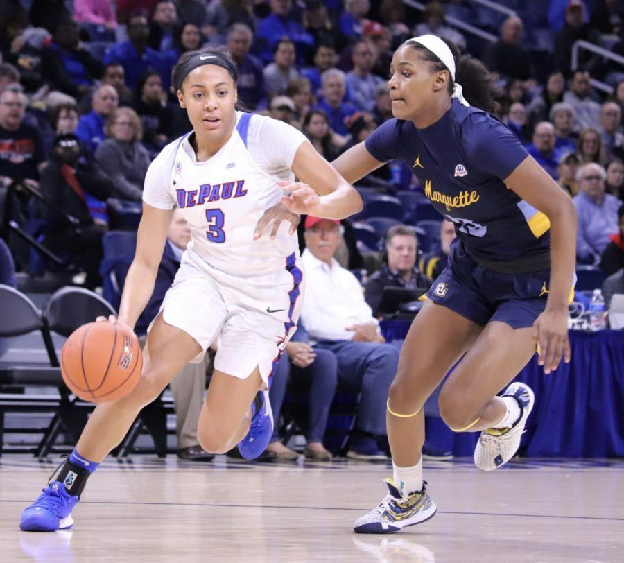 DePaul senior Deja Church drives to the basket against Destiny Strother in the Big East Tournament championship game on March 9 at Wintrust Arena.