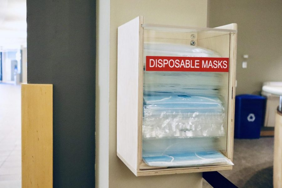 Disposable mask dispensary located in DePaul's Lincoln Park Student Center.