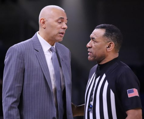 DePaul men's basketball head coach Dave Leitao talks to a referee during the Blue Demons' game against Georgetown on Feb. 8 at Wintrust Arena.