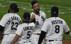 Chicago White Sox first baseman Jose Abreu, center, celebrates with his teammates after they defeated the Detroit Tigers in a baseball game, Saturday, Sept.12, 2020, in Chicago.