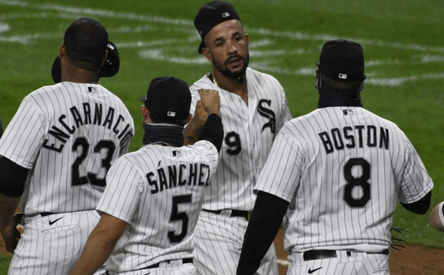 Chicago+White+Sox+first+baseman+Jose+Abreu%2C+center%2C+celebrates+with+his+teammates+after+they+defeated+the+Detroit+Tigers+in+a+baseball+game%2C+Saturday%2C+Sept.12%2C+2020%2C+in+Chicago.
