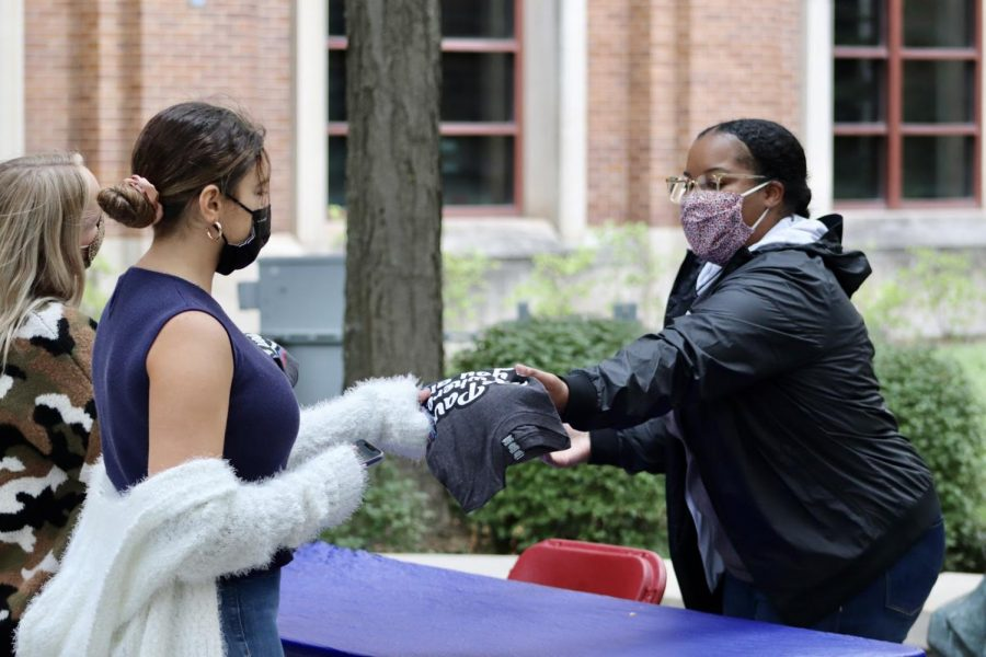 Students receive their free T-Shirt by St. Vincent's Circle as part of one of the few in-person events for Welcome a Week at DePaul University.