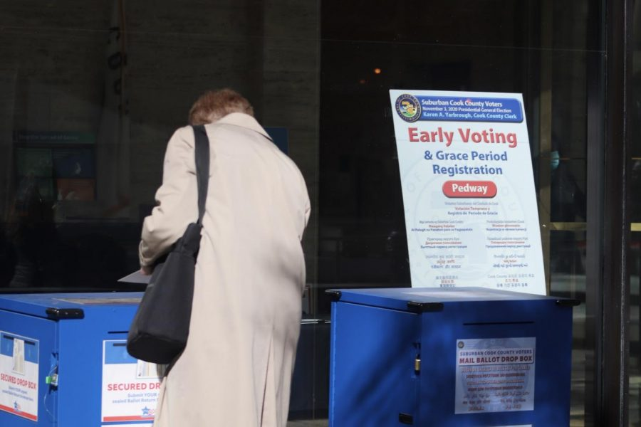 Voter casts their ballot early at Cook County Administration Building.