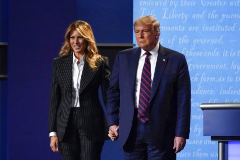 In this Sept. 29, 2020, file photo, President Donald Trump and first lady Melania Trump hold hands on stage after the first presidential debate at Case Western University and Cleveland Clinic, in Cleveland, Ohio. President Trump and first lady Melania Trump have tested positive for the coronavirus, the president tweeted early Friday. (AP Photo/Julio Cortez, File)