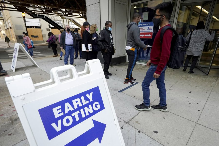 People wait in line to early vote at the Loop Super Site in downtown Chicago, Sunday, Oct. 11, 2020. (AP Photo/Nam Y. Huh)