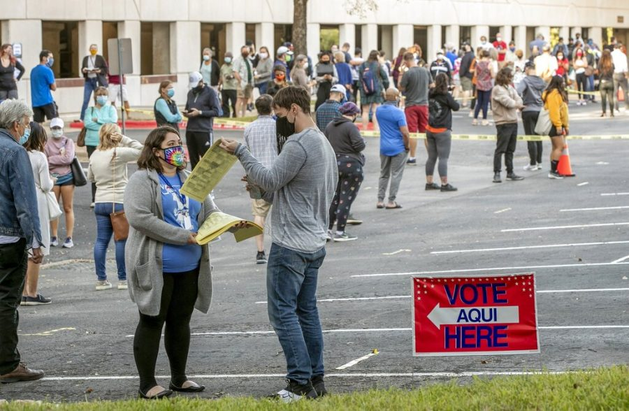 People+wait+in+a+long+line+to+cast+ballots+for+the+general+election+at+an+early+voting+location+at+the+Renaissance+Austin+Hotel+on+Tuesday%2C+Oct.+13%2C+2020%2C+in+Austin%2C+Texas.+%28Jay+Janner%2FAustin+American-Statesman+via+AP%29